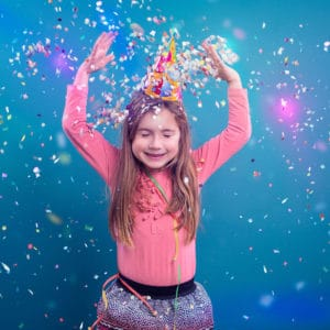 young girl with confetti